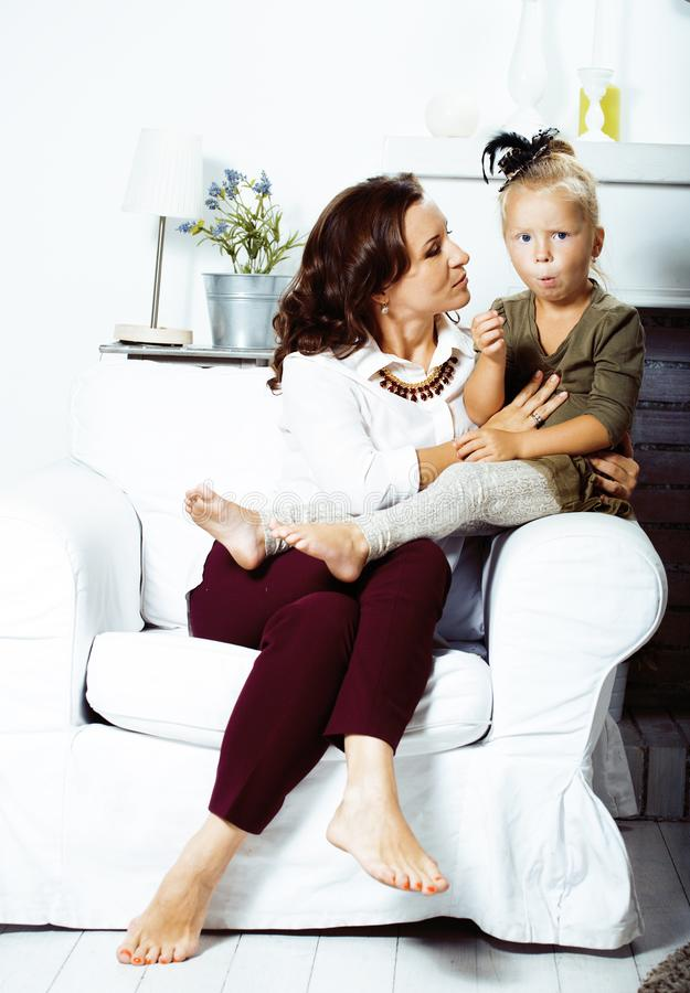 Happy smiling mother with little cute daughter at home interior, casual look modern real family, lifestyle people stock photo
