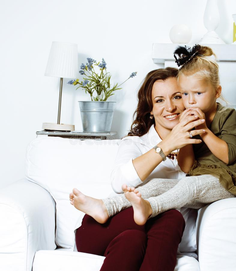 Happy smiling mother with little cute daughter at home interior, casual look modern real family, lifestyle people royalty free stock photography