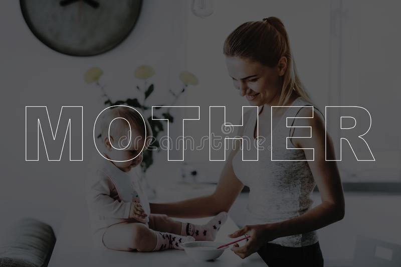 Mother feeding a little daughter royalty free stock photos