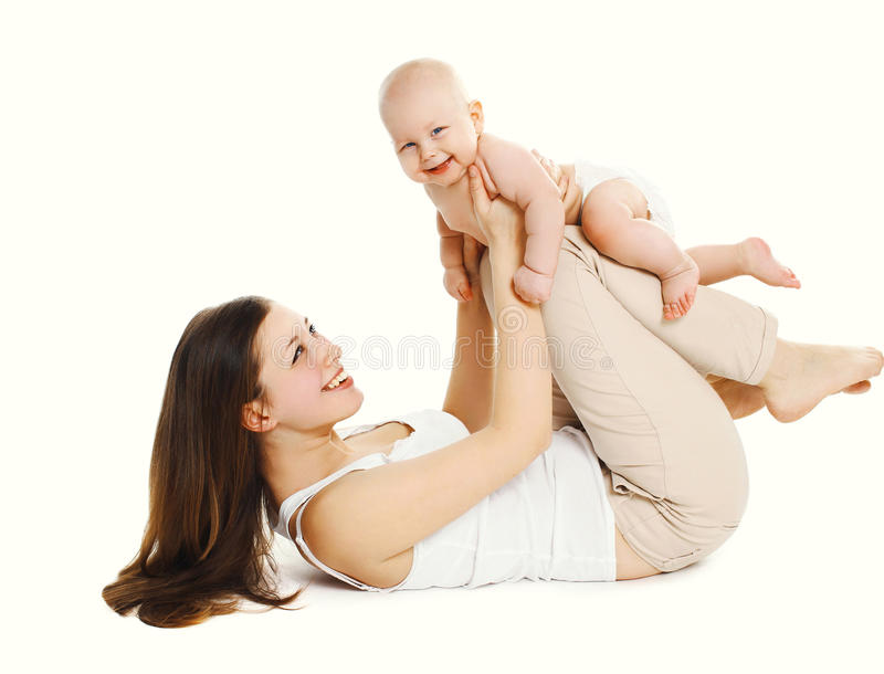 Happy smiling mother playing with baby on white stock photo