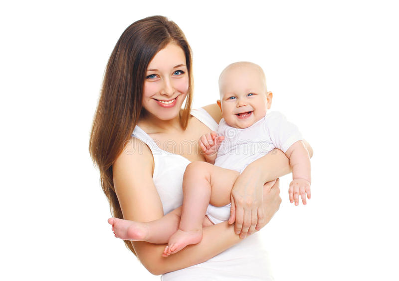 Happy smiling mother playing with baby on white stock image