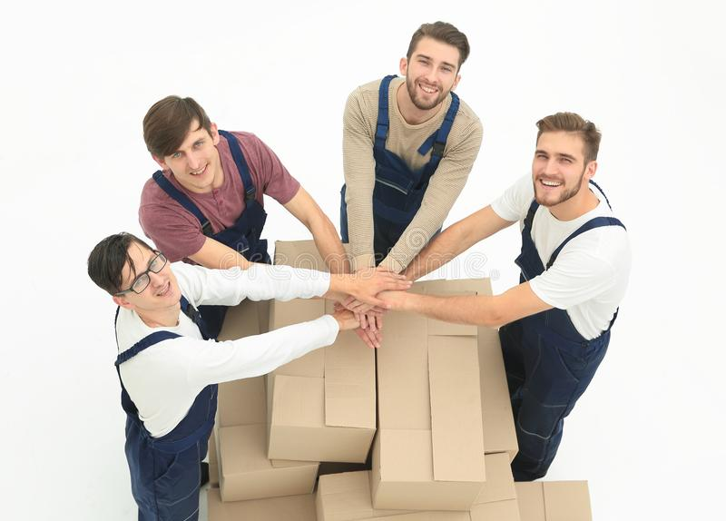 Happy smiling movers carrying boxes, isolated on white backgroun royalty free stock photography