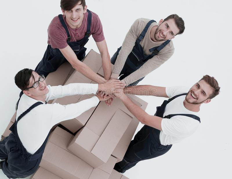 Happy smiling movers carrying boxes, isolated on white backgroun royalty free stock image