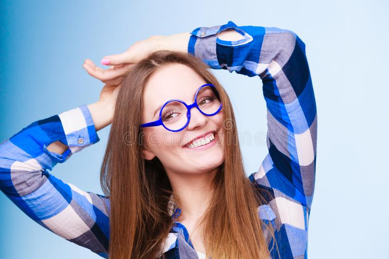 Happy smiling nerdy woman in weird glasses stock image