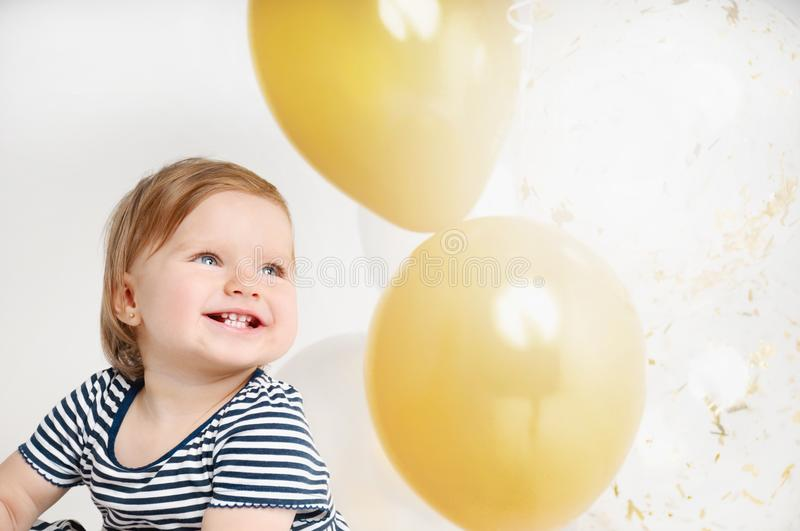 Happy and smiling one year old baby portrait with balloon background royalty free stock image