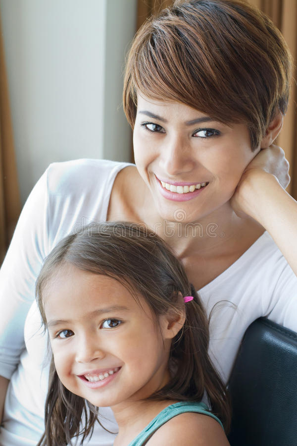 happy, smiling, positive family of mother and daughter stock photo