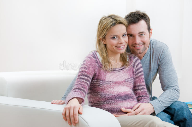 Happy smiling pregnant young couple royalty free stock image