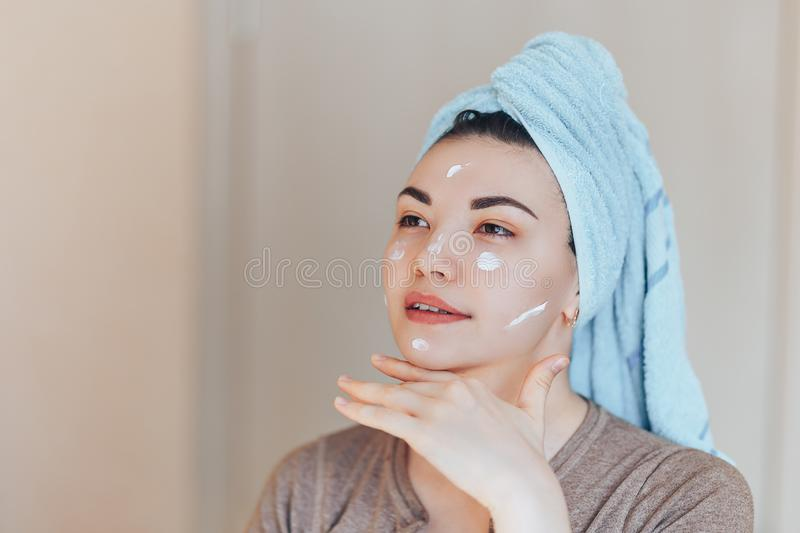 Happy smiling pretty beautiful woman girl with towel on head smiling touch healthy clean soft moisturized hydrated skin care after royalty free stock photos