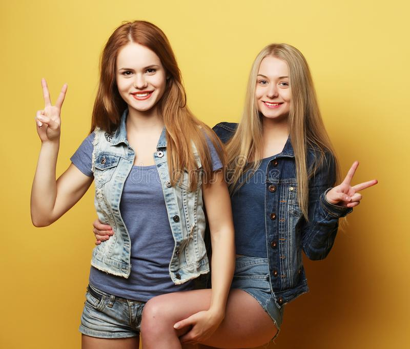 Happy smiling pretty teenage girls or friends stock photos