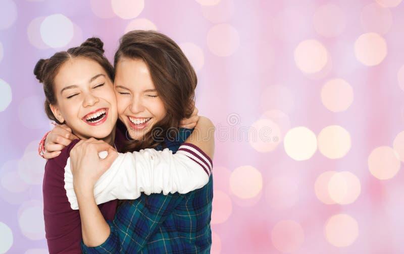 Happy smiling pretty teenage girls hugging royalty free stock photo