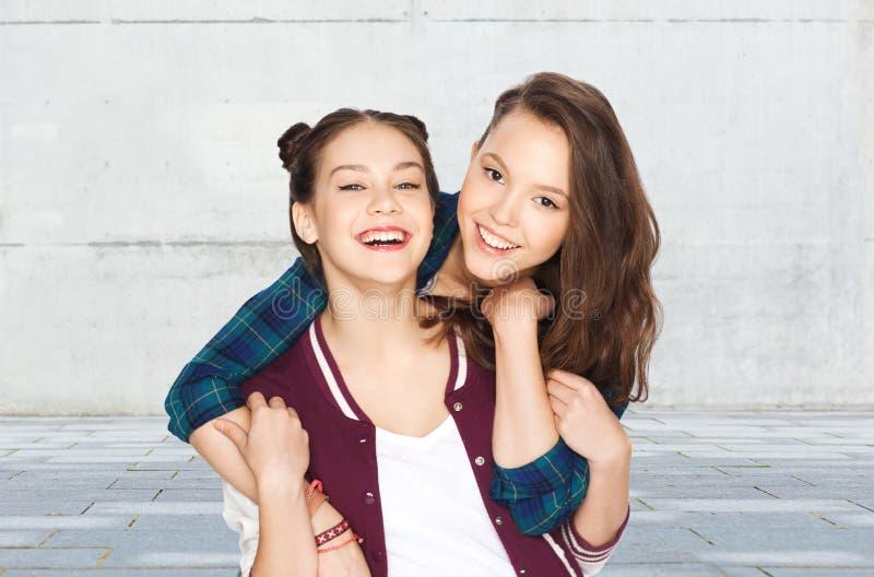 Happy smiling pretty teenage girls hugging royalty free stock image