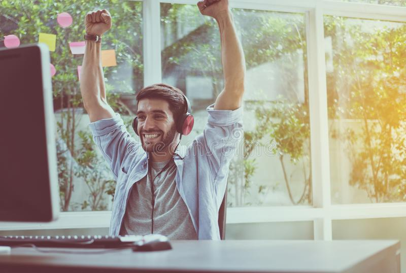 Happy and smiling,Relax time,Sucessful men hands rais up with winner game online. Happy and smiling,Relax time,Sucessful man hands rais up with winner game royalty free stock photos