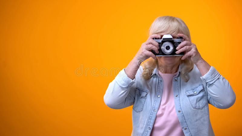Happy smiling retiree woman taking photo, hobby and relaxation, leisure time stock photos