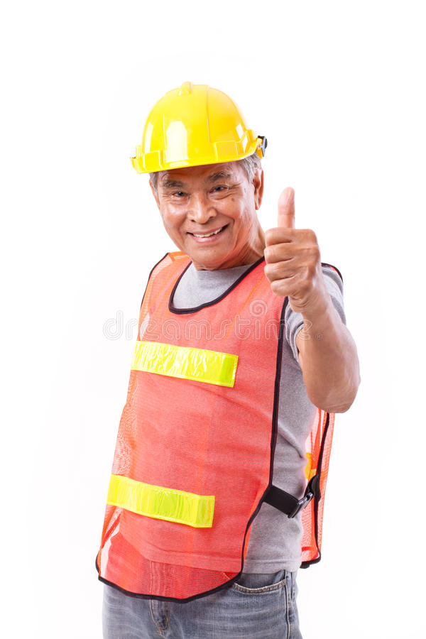 Happy, smiling senior construction worker giving thumb up stock image