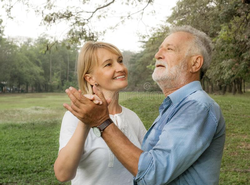 Happy smiling senior couple in love happy in park, dancing and having fun, Happy life stock image