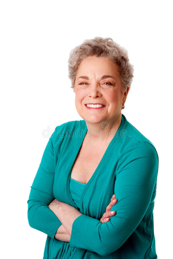 Happy smiling senior woman with arms crossed stock photo