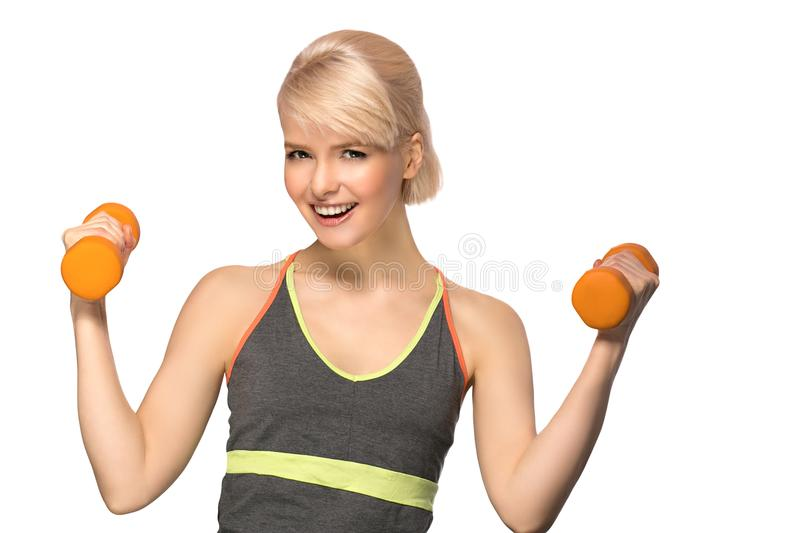 Woman with dumbbells. Happy smiling slim woman with dumbbells isolated on white background stock images