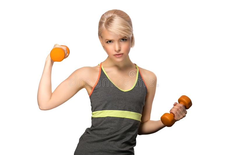 Woman with dumbbells. Happy smiling slim woman with dumbbells isolated on white background stock photography