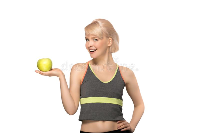 Woman holding apple stock photography