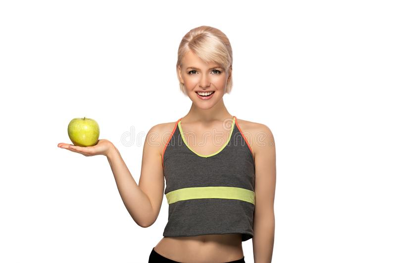Woman holding apple. Happy smiling slim woman holding green apple, studio portrait isolated on white background, healthy lifestyle concept stock photography