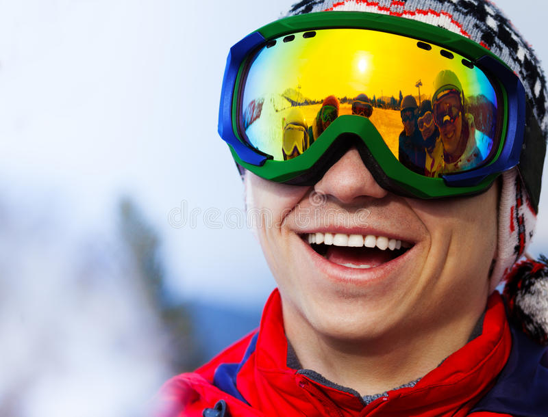 Happy smiling snowboarder in ski mask portrait stock photography