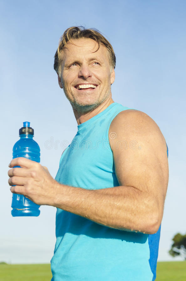 Happy smiling sportsman stock images