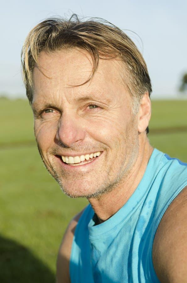 Happy smiling sportsman royalty free stock photo