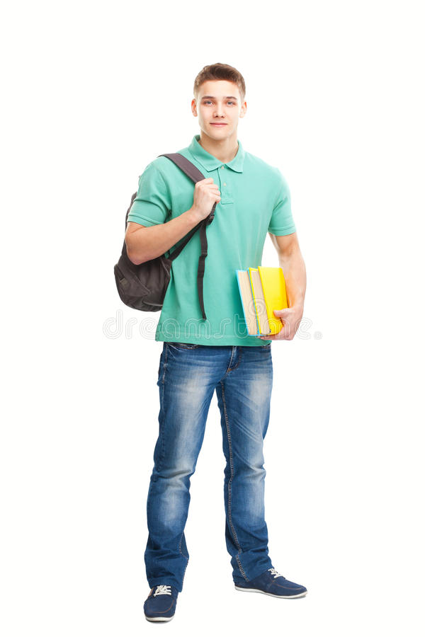 Happy smiling student with books and backpack stock image