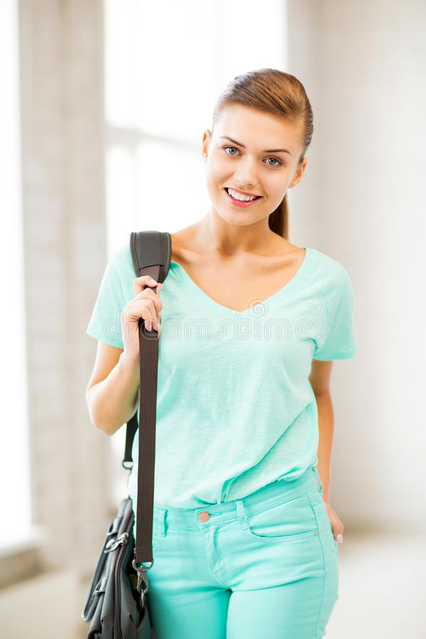 Happy smiling student girl with school bag royalty free stock images