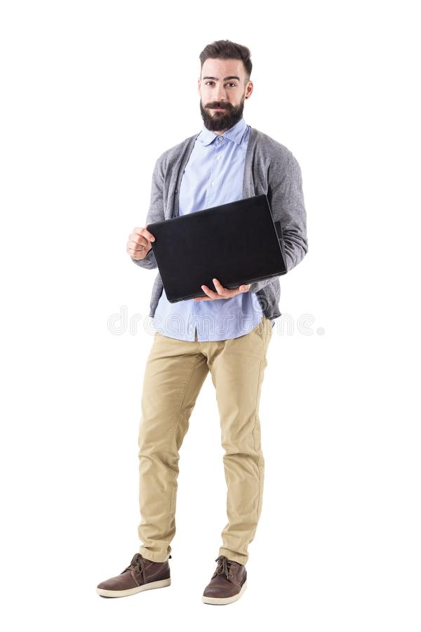 Happy smiling successful businessman opening laptop and looking at camera. stock photography