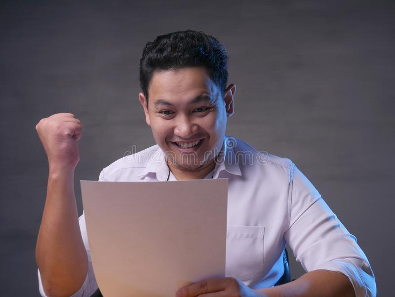 Happy Smiling Surprised Businessman Reading Positive Financial Report royalty free stock images