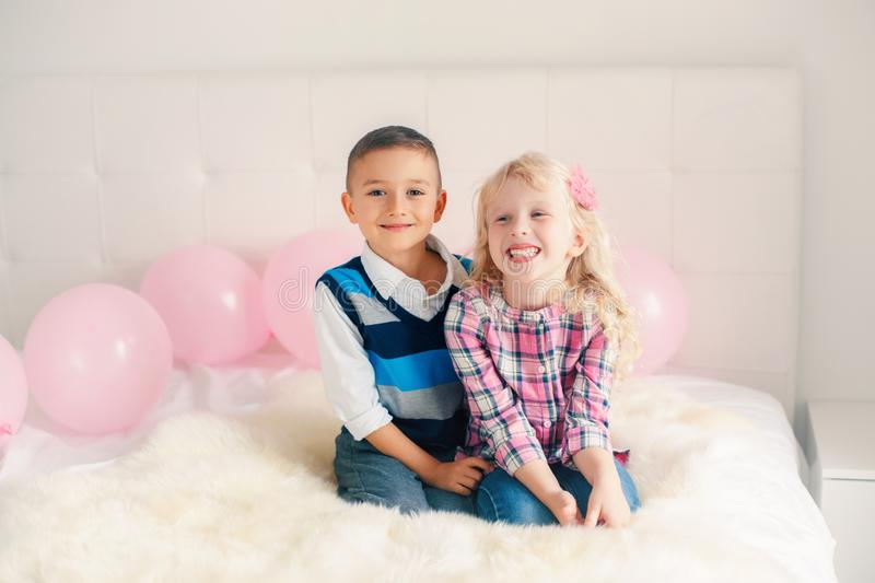 Happy smiling surprised white Caucasian cute adorable funny children stock photo