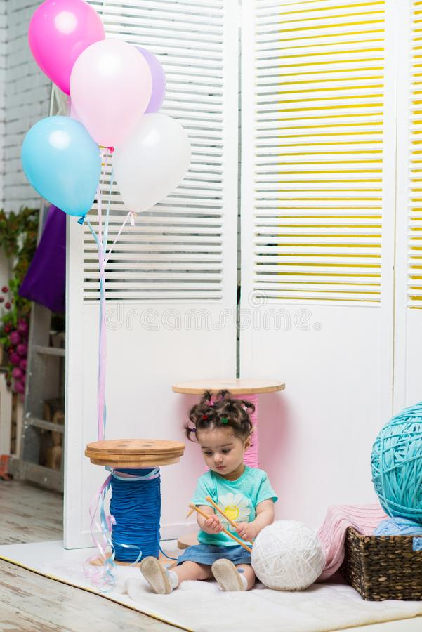 Happy smiling sweet baby girl sitting on sofa, Birthday girl, One year old stock image
