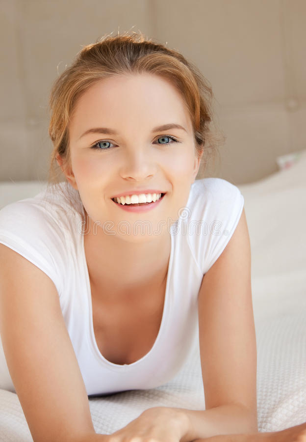 Happy and smiling teenage girl. Bright picture of happy and smiling teenage girl royalty free stock photography