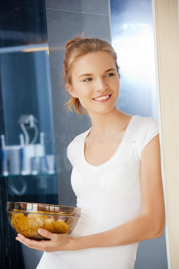 Download Happy And Smiling Teenage Girl With Chips Stock Image - Image of enjoying, food: 39513983