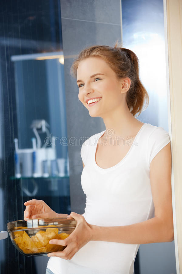 Download Happy And Smiling Teenage Girl With Chips Stock Image - Image of inside, happiness: 39515227