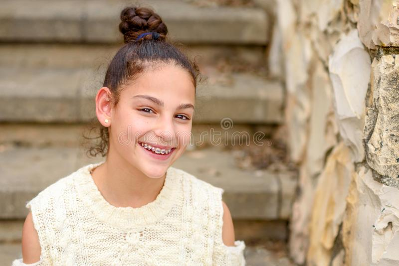 Happy smiling teenage girl with dental braces. royalty free stock images
