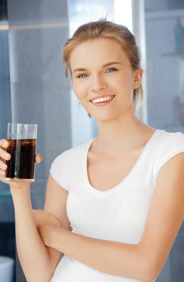 Download Happy And Smiling Teenage Girl With Glass Of Cola Stock Image - Image of indoors, lovely: 39515229