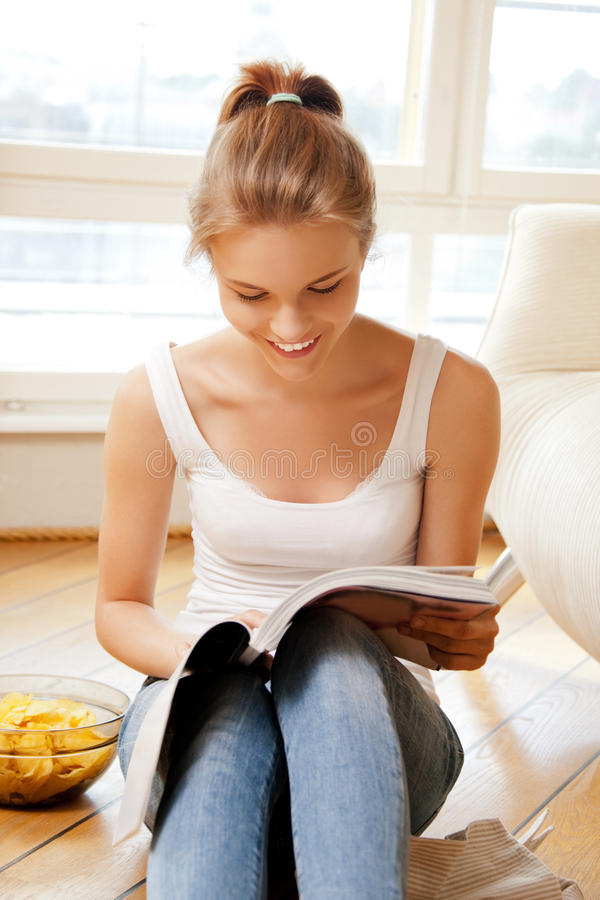 Download Happy And Smiling Teenage Girl With Magazine Stock Photo - Image of news, enjoying: 39515116