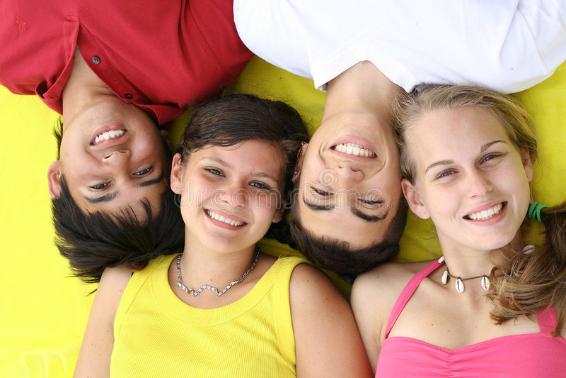 Happy smiling teens. Beautiful teeth.group stock photo