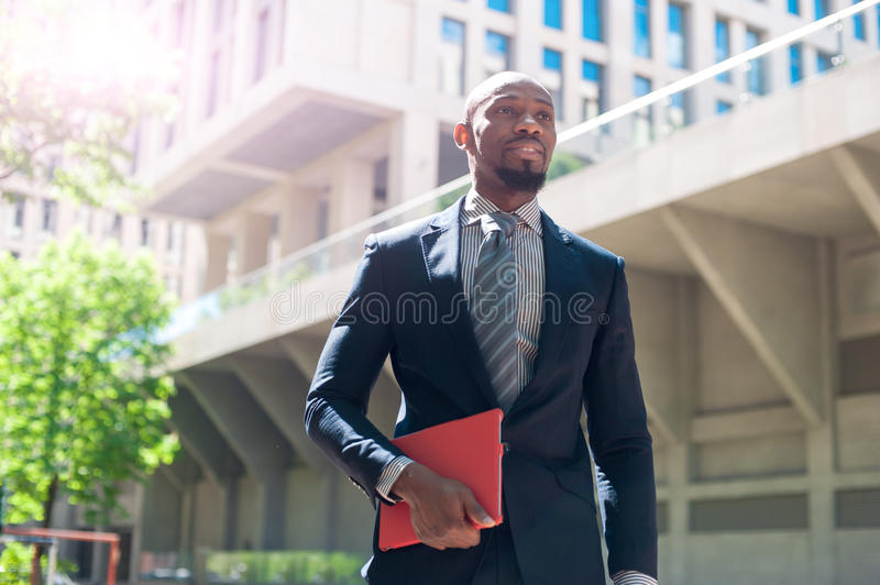 Happy smiling urban professional man using tablet computer in ur royalty free stock photos