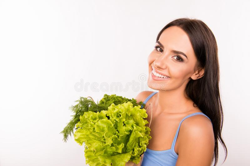 Happy smiling woman with bag full of greens and vegetables stock photography