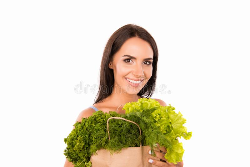 Happy smiling woman with bag full of greens and vegetables stock images