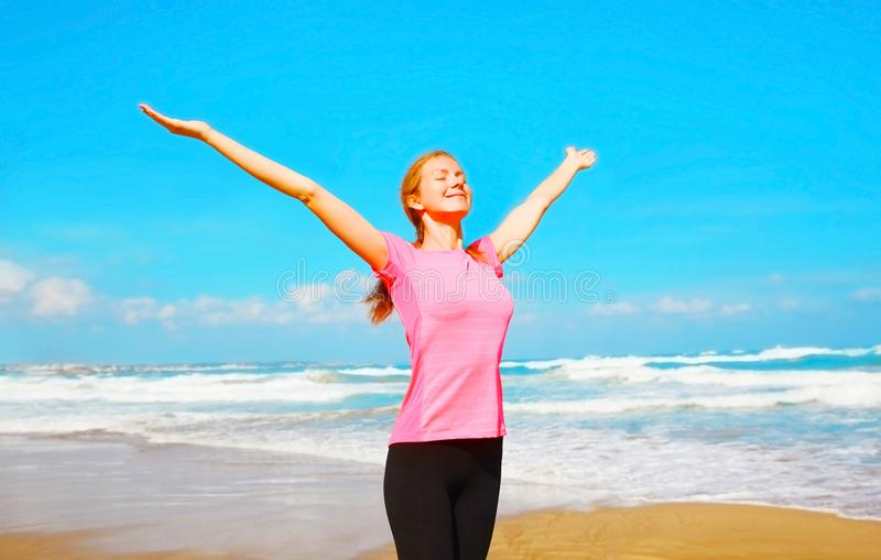 Happy smiling woman on the beach near the sea royalty free stock image