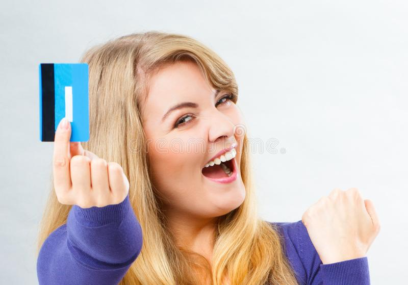 Happy smiling woman with credit card, concept of cashless paying for shopping stock photo