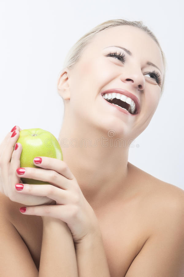 Happy Smiling Woman Dieting with Green Apple. Healthy Lifestyle, Nutritious and Organic Food Concepts royalty free stock images