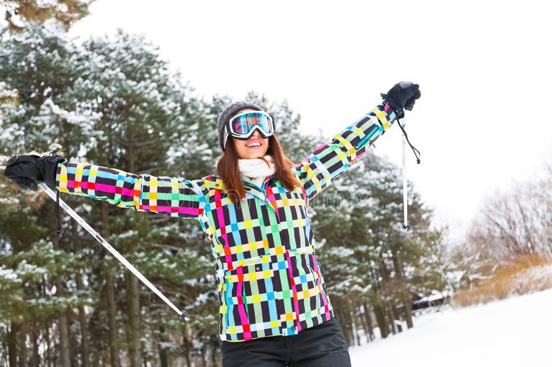 Happy smiling woman finish downhill through high mountain stock photography