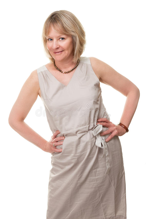 Happy Smiling Woman with Hands on Hip. Portrait of Happy Smiling Attractive Mature Woman with Hands on Hips Isolated stock photo