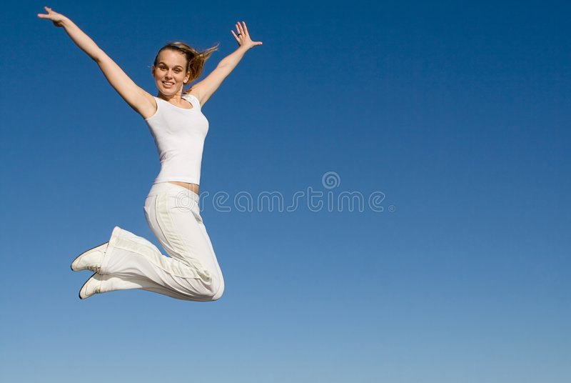 Happy smiling woman jumping stock image