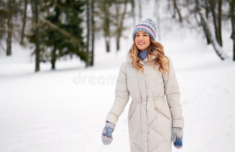 Happy smiling woman outdoors in winter forest royalty free stock photography